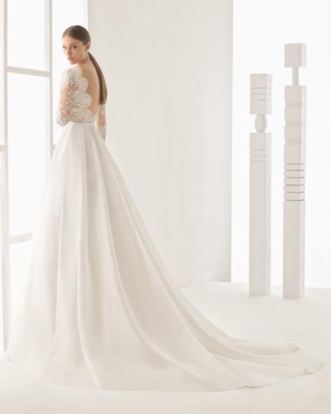 Nilo vestido de encaje y garza de seda.