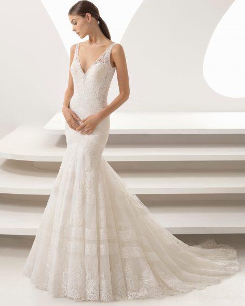 Vestit de núvia tall sirena en guipur i blonda, pedreria amb escot en V.
