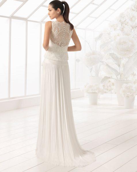 Boho-style beaded lace and silk muslin wedding dress.