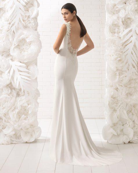 Mermaid-style beaded crepe wedding dress with jewelled back.