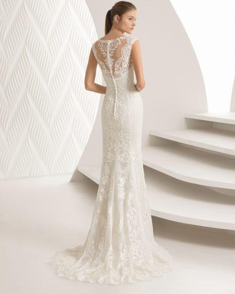 Vestit de núvia tall sirena en guipur, amb escot de cor, de color perla.