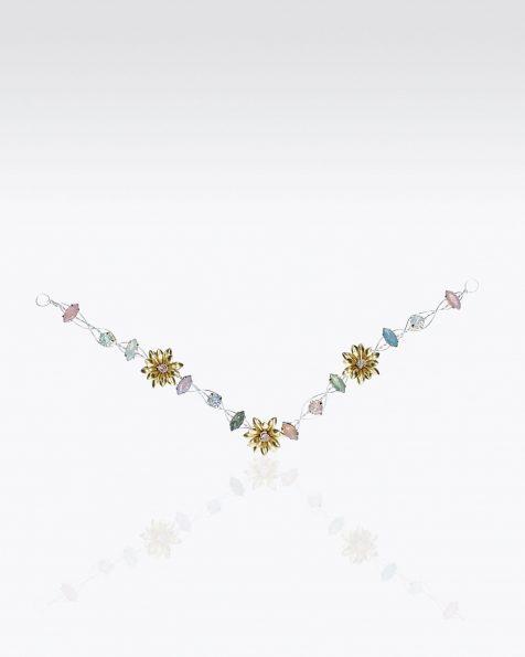 Tocado de novia en plata y cristal. Disponible en color oro y tonos pastel. Colección ROSA CLARA COUTURE 2019.