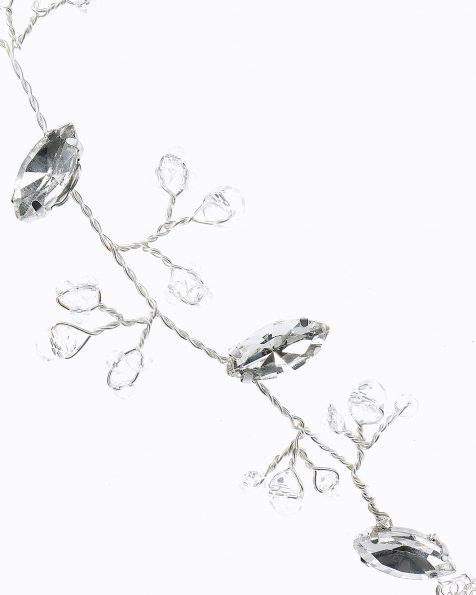 Tocado largo de novia de hojas tejidas en plata y cristal. Disponible en color plata. Colección ROSA CLARA COUTURE 2019.