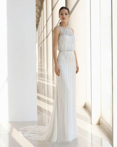 Vestido de novia corte recto de seda y pedrería. Ablusonado con cinturón. Disponible en color natural/plata y natural. Colección ROSA CLARA SOFT 2019.