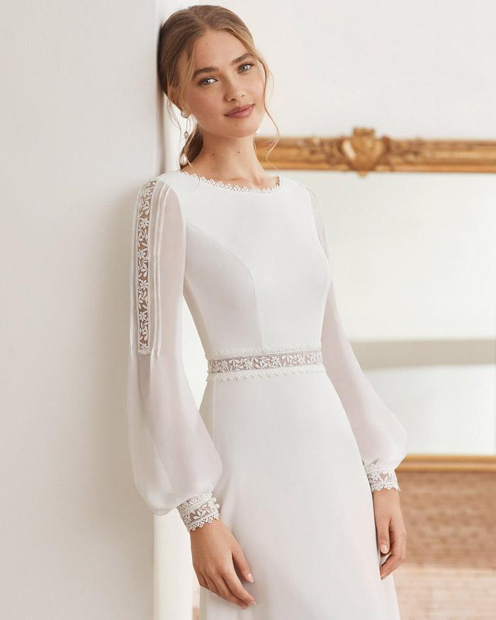 O artesanato dos vestidos de noiva de renda e chantilly
